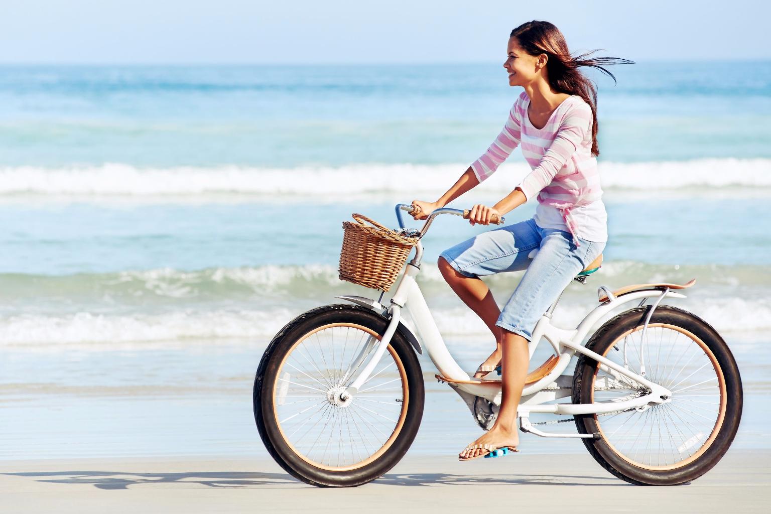 woman-on-bike-on-beach-xl1